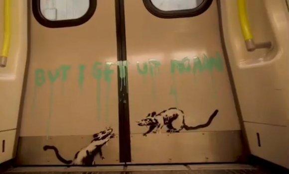 Бенксі малює графіті у Львівському метро